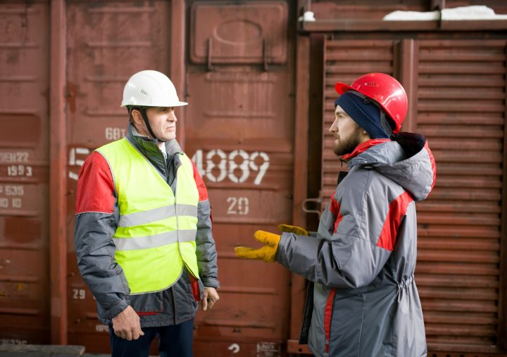 Worker Talking to Supervisor in Docks